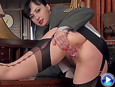 Nikita wears her military uniform and plays
