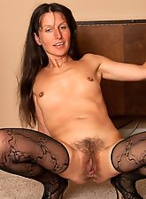 Mature Carmen spreads her furry beaver