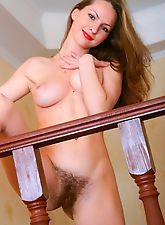 Irina S mounts the stairs in nothing but hair