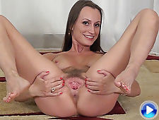 Izolda strips naked and rubs her hairy pussy
