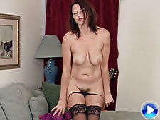 Gina Louise removes dress and stockings to show body