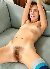 Thin and redheaded Matilda showing off her hairy pits and pussy
