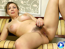 Hairy girl Silviya stretches and then strips