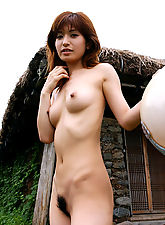 Naked Japanese tramp enjoys the freedom showing hairy pussy and fine tits a lot