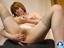 Strea strokes her stockings and hairy pussy