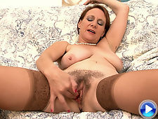 Hairy woman Tiffany T kills time by masturbating