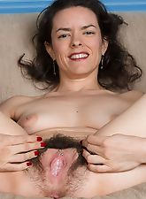 Lucia strips to show off rose thong & hairy pussy